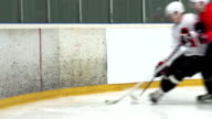 HD:Shot of Two Ice Hockey Players Duelling by the Fence video