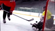 HD: Slo-Mo Shot of Young Ice Hockey Player Practicing Penalty Shot video