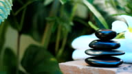 HD:Spa still life of zen stone, candle and massage oil video