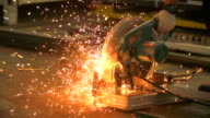 HD:Sparks while grinding steel pipe. video
