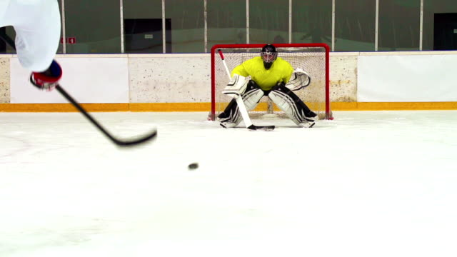 HD:Super Slo-Mo Shot of Young Ice Hockey Players Practicing video