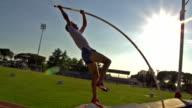 HD:Super Slo-Mo Shot of Young Man at Pole Vault video