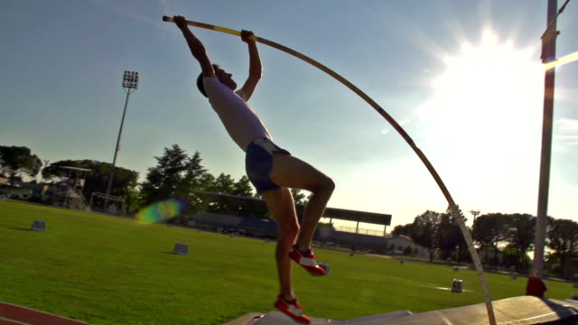 HD:Super Slo-Mo Shot of Young Man at Pole Vault video