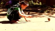 HD:Thai boy playing top. video