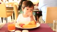 HD:Toddler boy eating breakfast by himself. video