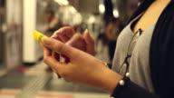 HD:Woman touching smart phone on subway station. video