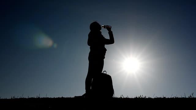 HD:Woman traveller take a break for drinking water on mountain video