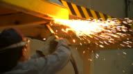HD:Worker using torch cutter to cut through metal video