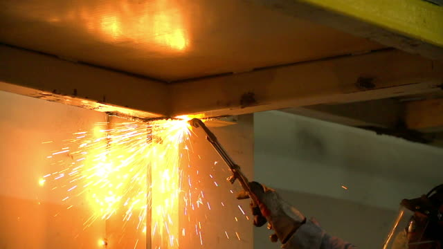 HD:Worker using torch cutter to cut through metal video