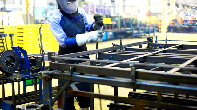 HD:Worker using welding machine on his work. video