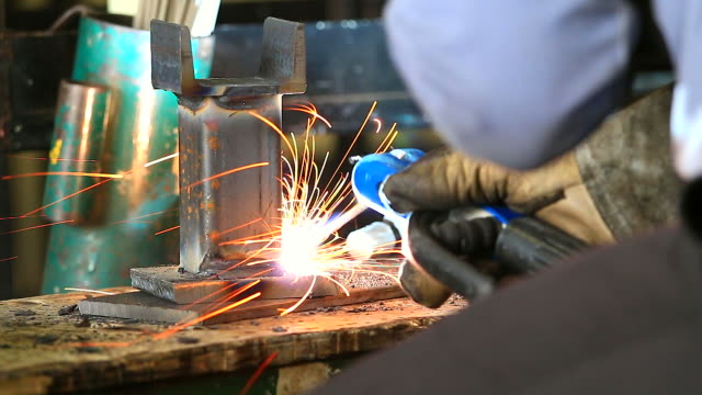 HD:Worker using welding machine on his work. video