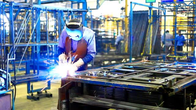 HD:Worker with helmet during welding work. video