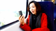 HD:Young asian woman chat with her friend on the train. video