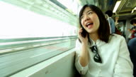 HD:Young asian woman talking on cellphone. video