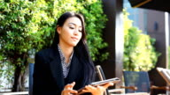 HD:Young business woman working with tablet. video