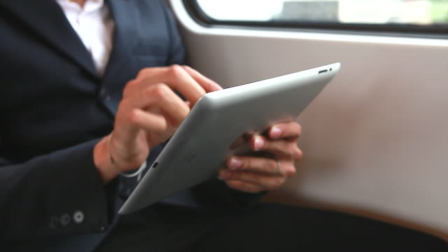 HD:Young businessman using mobile phone on the train. video