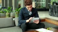 HD:Young businessman working by using tablet. video