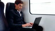 HD:Young businessman working on the train. video