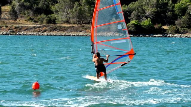 HD:Young male windsurfer at slalom regatta video