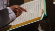HD:Young man reading the Koran at the mosque. video