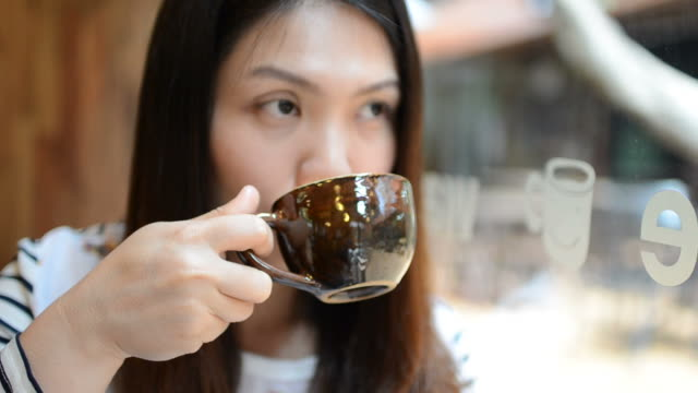 HD:Young woman drinking coffee for break time video