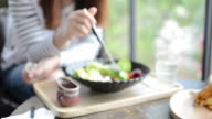 HD:Young woman eating salad with cream souce video