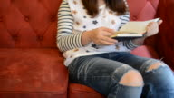 HD:Young woman reading book in relax time video