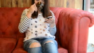 HD:Young woman using smartphone at coffee break time video