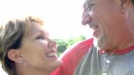 Head and Shoulders Portrait Of Senior Couple In Garden video