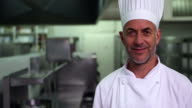 Head chef giving thumbs up and smiling at camera video