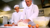 Head chef showing trainee how to prepare dough video
