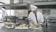 Head male chef chopping vegetables to finish the dishes video