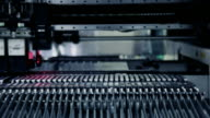 Head SMT takes electrical component into feeder video