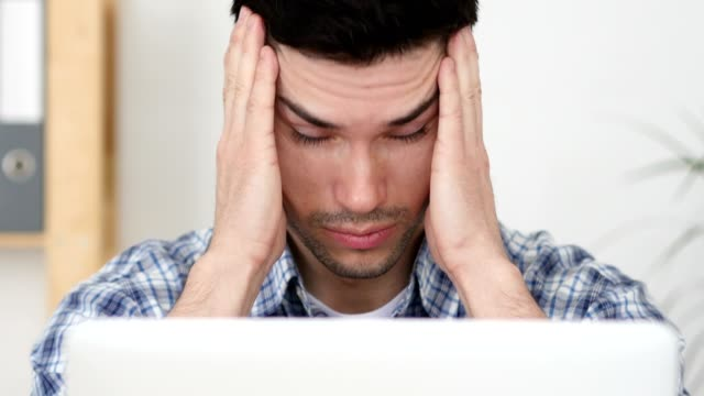 Headache, Man Working on Laptop with Head Pain, Close Up video