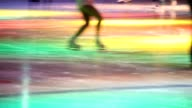 Headless people are in skating rink with illumination video