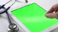 Health Care Worker with tablet green screen video