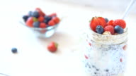 Health food concept - chia seed pudding or smoothie with berries. video