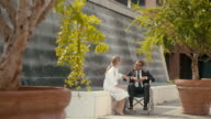 Health issues, handicapped man, patient on wheelchair with clinic doctor video