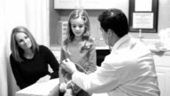 Healthcare. Little girl patient with pediatrician doctor. Check-up, exam. video