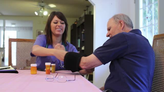 Healthcare Professional Checks Senior's Blood Pressure video