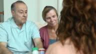 Healthcare Professional Explaining Prescription Dosages b video