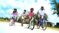 Healthy Ethnic Family Cycling Together video