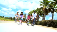 Healthy Ethnic Family Enjoying Cycling Together video