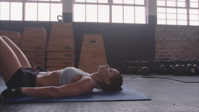 Healthy female athlete taking a break from fitness training video