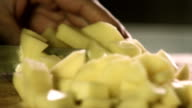 healthy fresh food prep cutting up of vegetable potato video