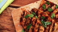 Healthy grilled pork fillets sprinkled with fresh herbs video
