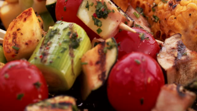 Healthy grilled vegetables on a plate outdoors on wooden table video