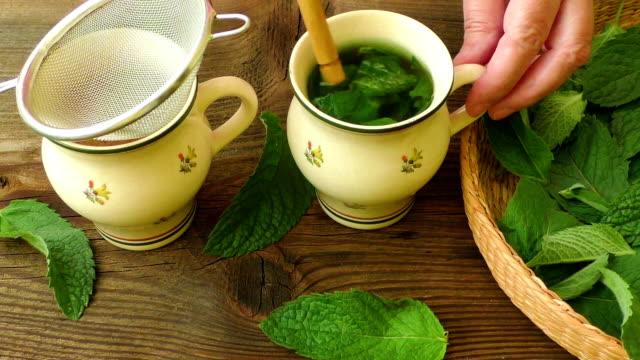 Healthy herb tea prepare. Fresh made Mint Tea video