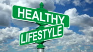 Healthy Lifestyles Street Intersection Sign With Beautiful Time Lapse Sky video