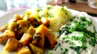Healthy plate of nutritious food. Potatoes fish and veggie video